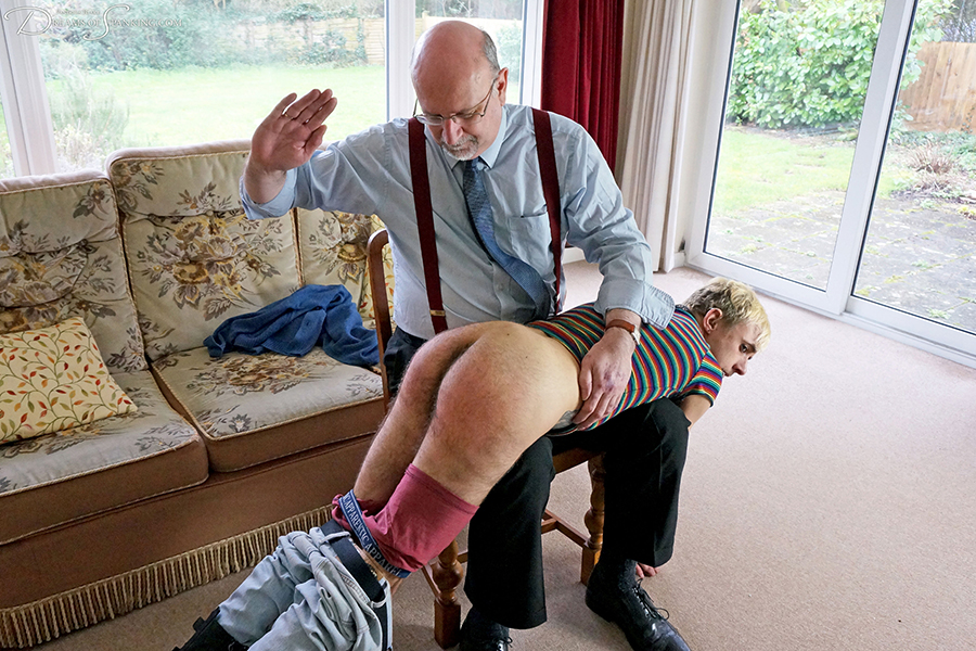Queer youth Fauni Cate is punished by this uncle with a hard over the knee spanking