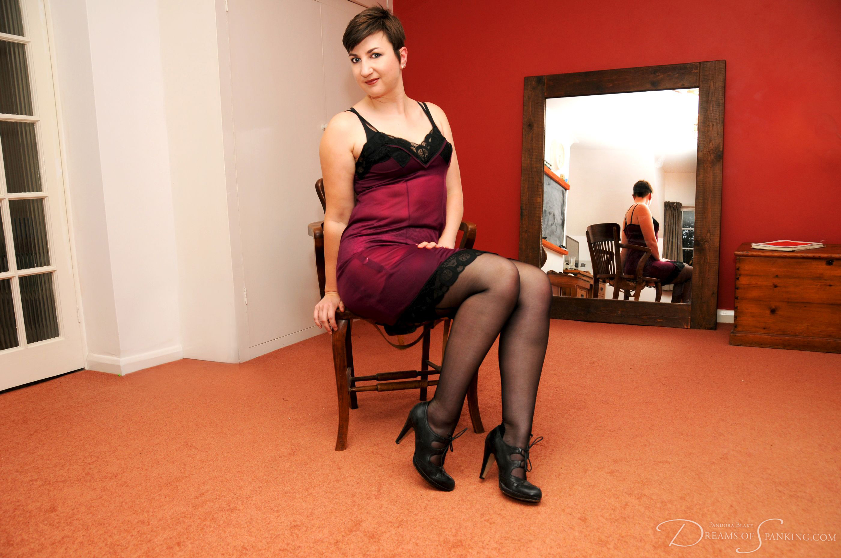 Pandora Blake shows off their high heels and stockings at Dreams of Spanking