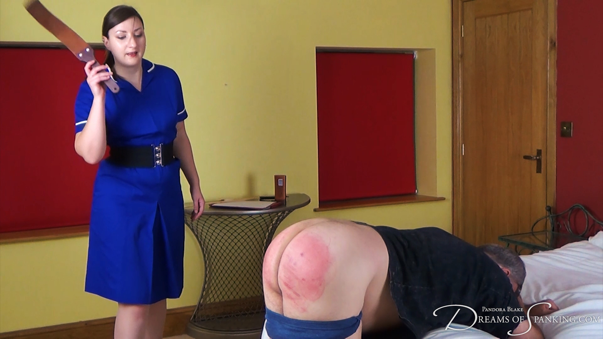 Nurse Pandora Blake administers therapeutic spanking therapy to Mike Pain in The Russian Treatment at Dreams of Spanking