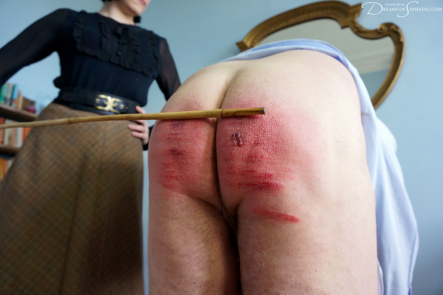 A severe caning from the strict headmistress