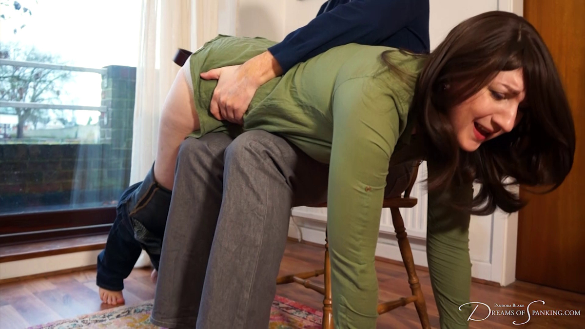 Pandora Blake is over Stephen Lewis's knee at Dreams of Spanking