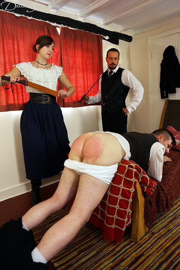 Historical spanking scene from Dreams of Spanking - stableboy thrashed by master and mistress