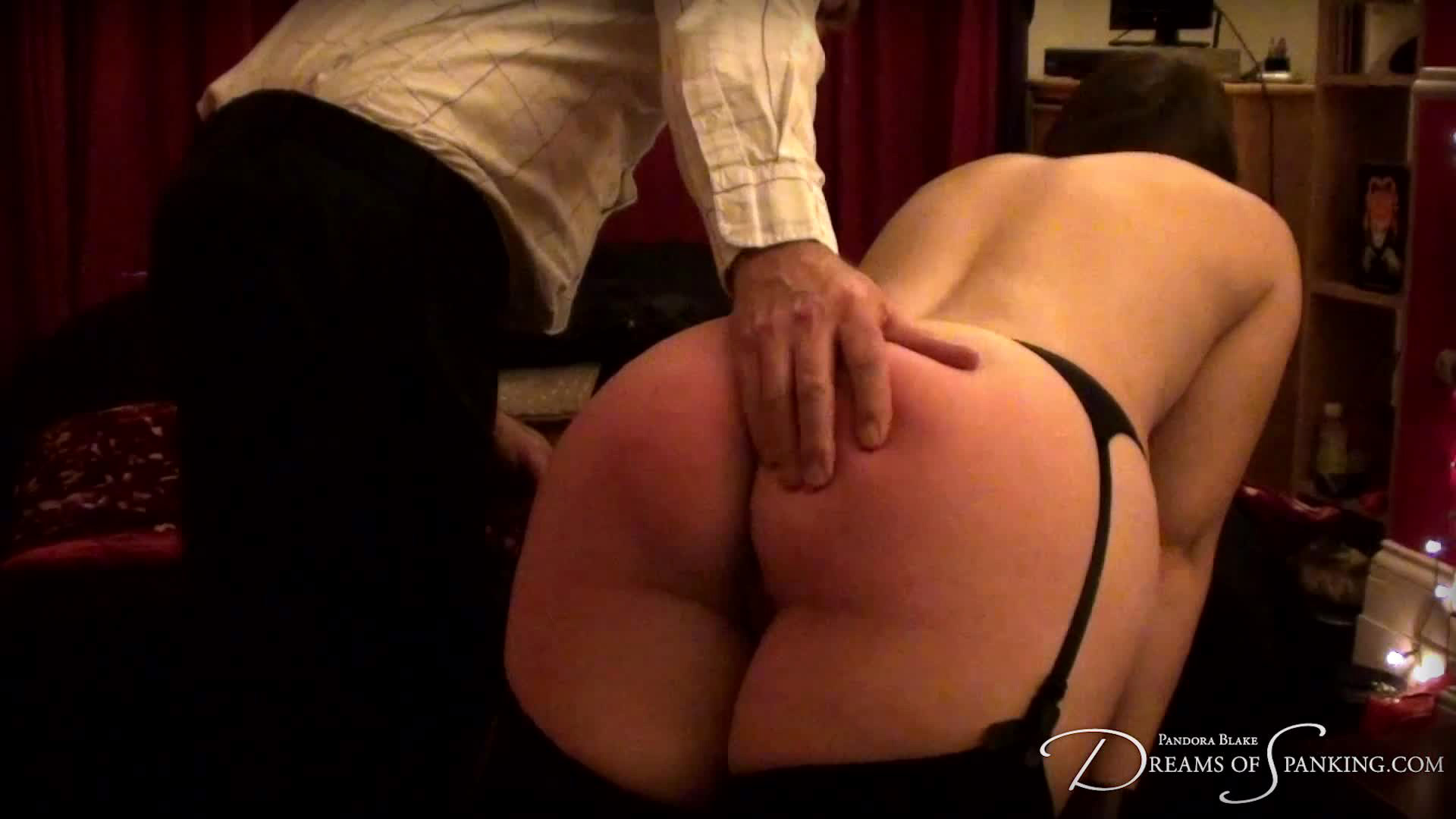 Pandora Blake receives a hard strapping and caning at Dreams of Spanking