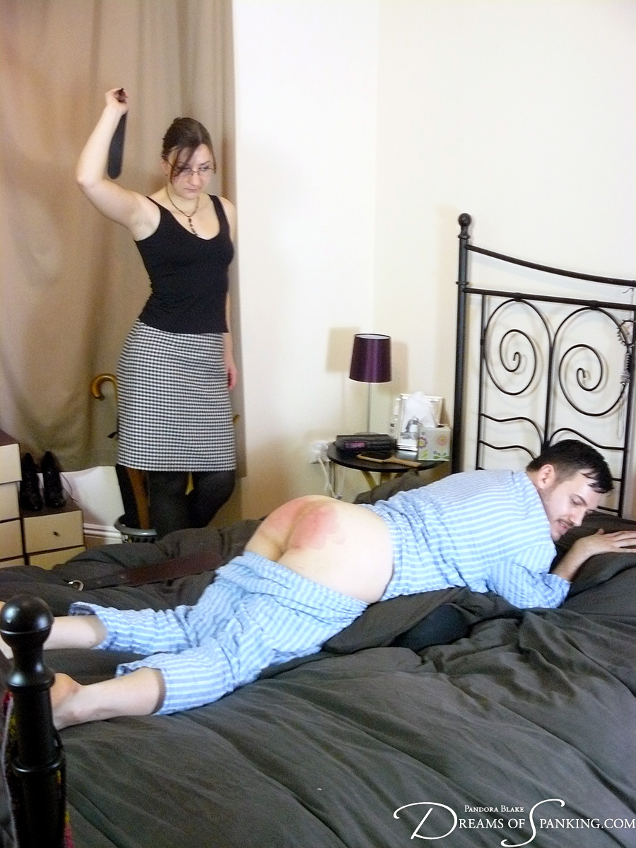 Pandora Blake strapping Michael Darling at Dreams of Spanking