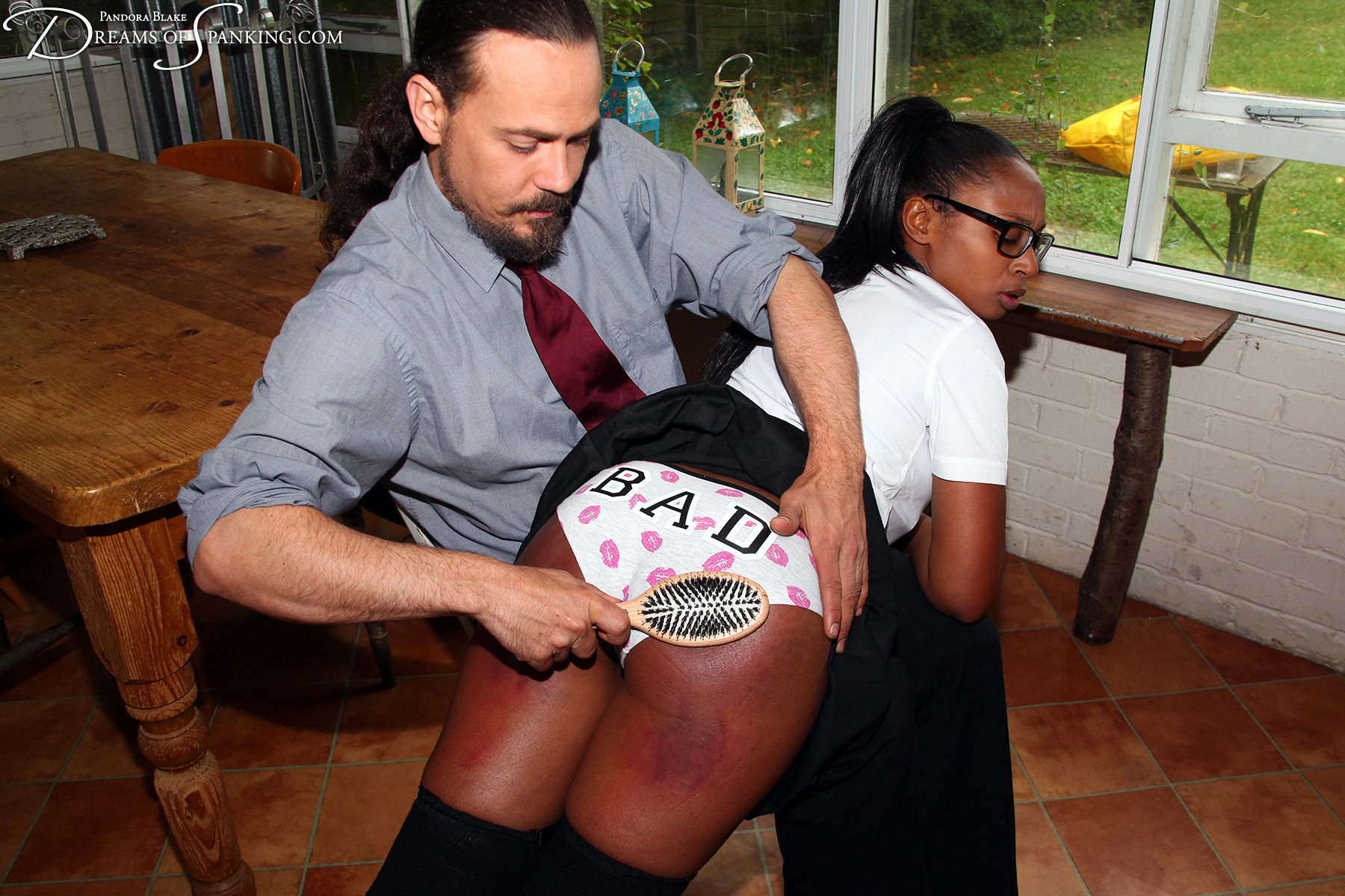 Schoolgirl Lola Marie spanked with a hairbrush at Dreams of Spanking