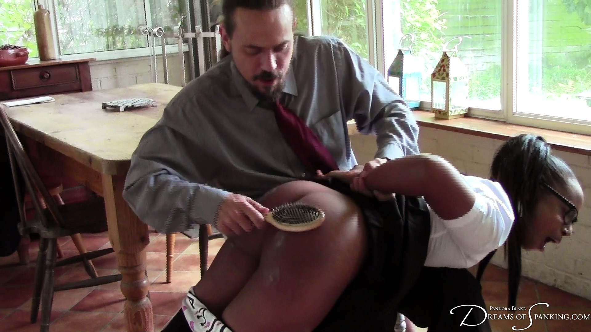 Severe wooden hairbrush punishment for Lola Marie at Dreams of Spanking