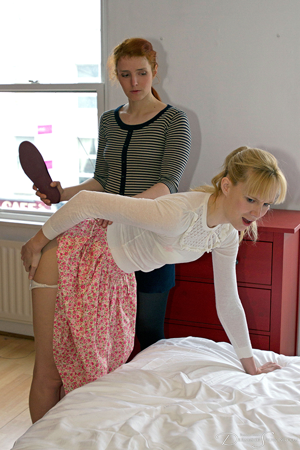 Caroline Grey shows Amelia Jane Rutherford how to use the slipper