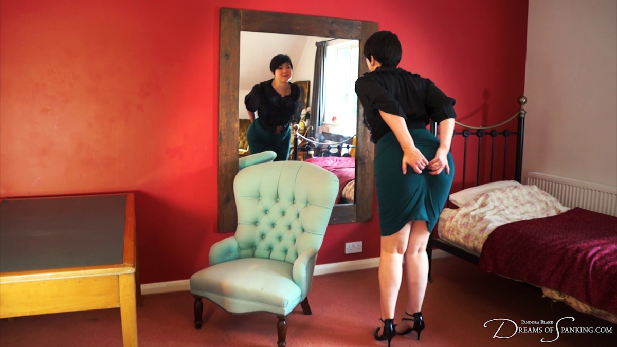 Pandora Blake grabbing her butt in a tight green skirt and admires herself in the mirror