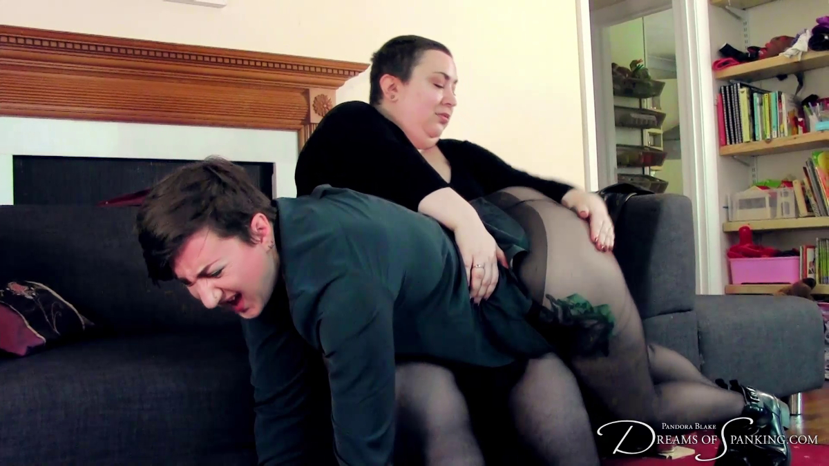 Pandora Blake gets a hard hand spanking from Nimue Allen over her tights at Dreams of Spanking
