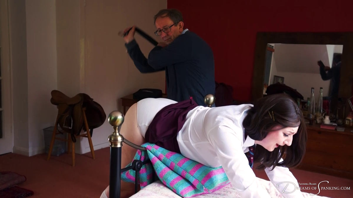 Pandora Blake gets the leather belt on her bare bottom from David Oak at Dreams of Spanking