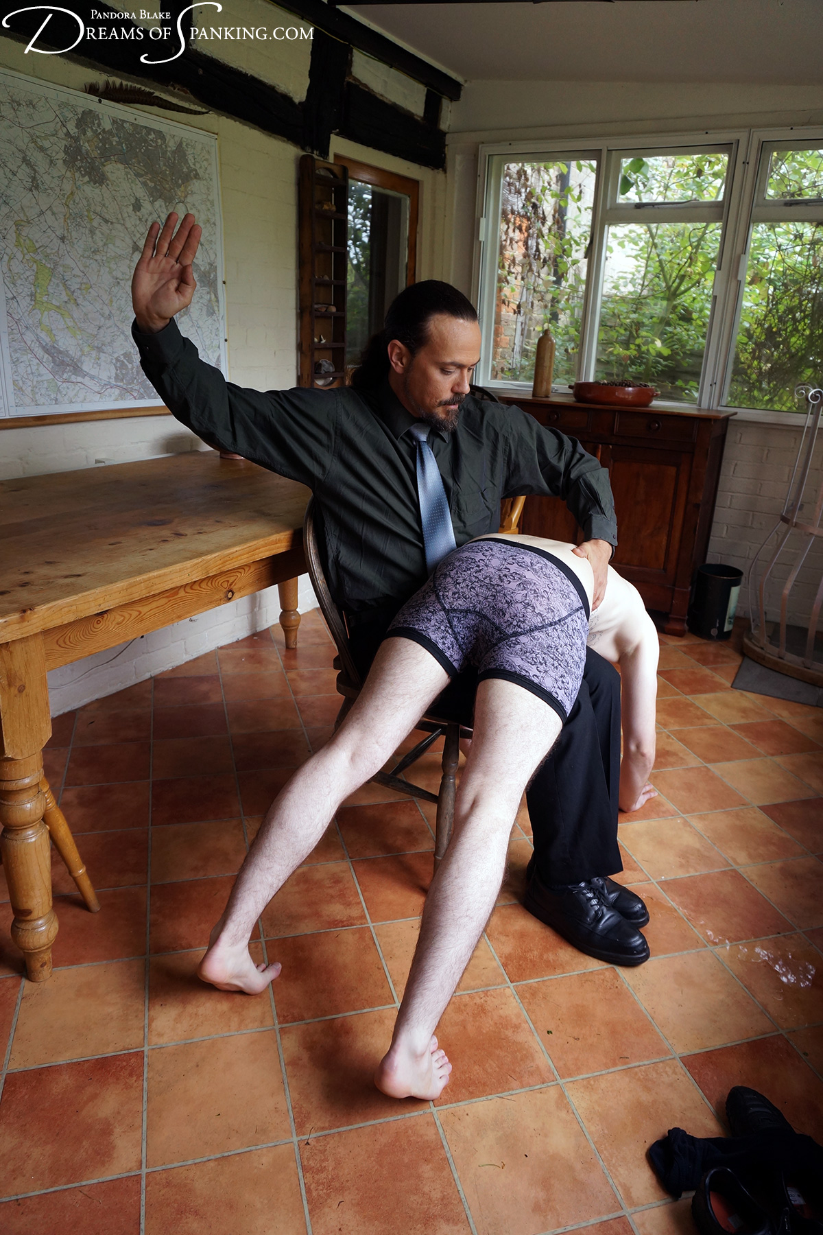 Son taken over the knee by his strict dad at Dreams of Spanking