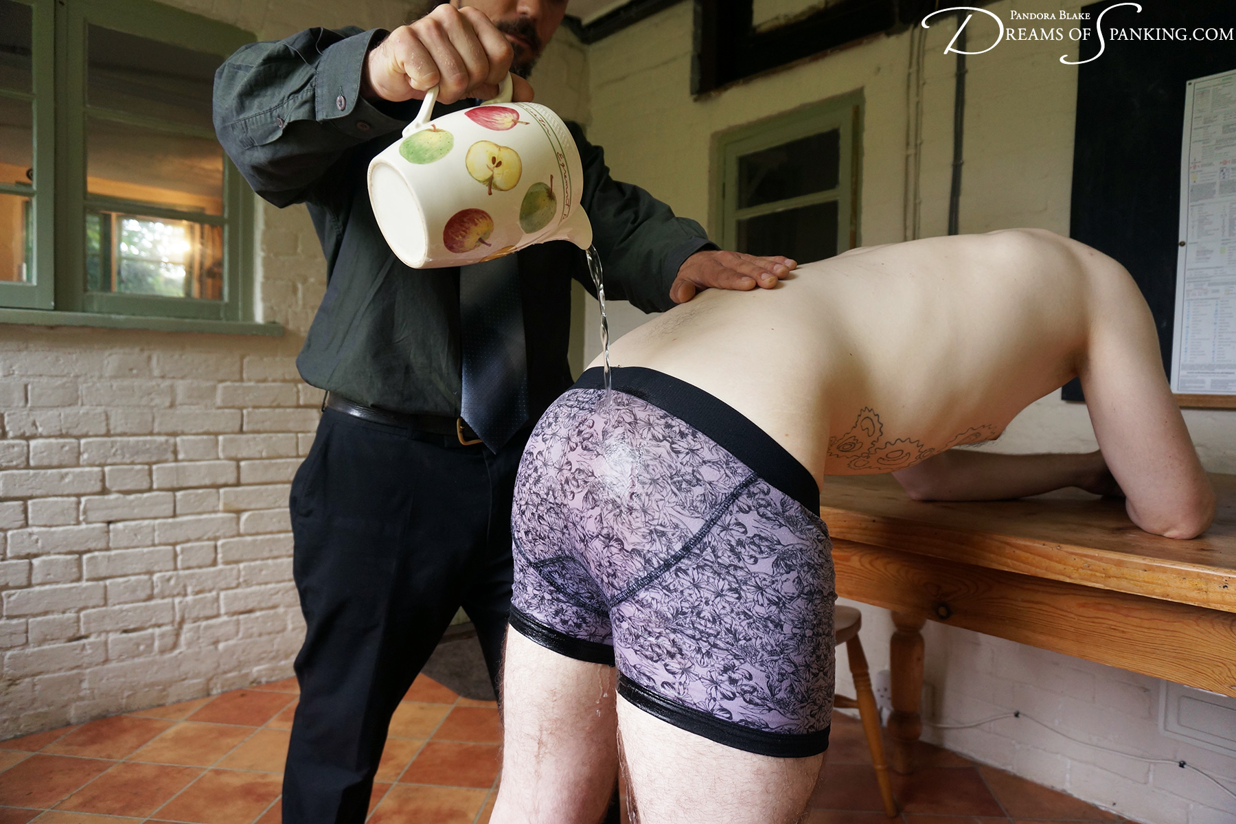 Cold water poured over Andrew's tight briefs at Dreams of Spanking