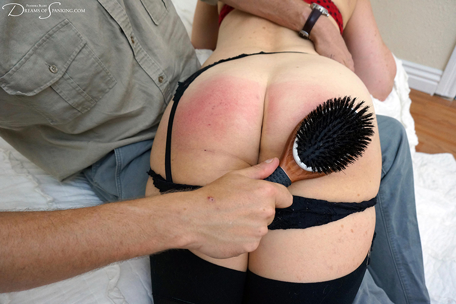 Spanked wife Erica Scott gets the wooden hairbrush and leather strap at Dreams of Spanking